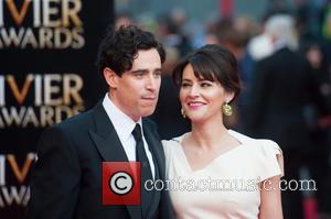 Stephen Mangan and Louise Delamere - Olivier Awards 2014 held at the Royal Opera House - Arrivals - London, United...