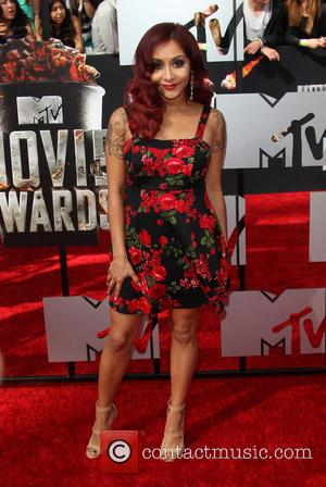 Nicole Polizzi and Snooki - The 23rd Annual MTV Movie Awards at Nokia Theatre on April 13, 2014 in Los...