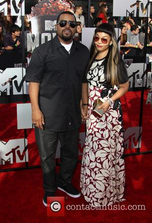 Ice Cube and Kimberly Woodruff - The 23rd Annual MTV Movie Awards at Nokia Theatre on April 13, 2014 in...