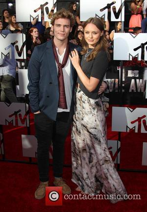 Laura Haddock and Sam Claflin - The 23rd Annual MTV Movie Awards at Nokia Theatre on April 13, 2014 in...