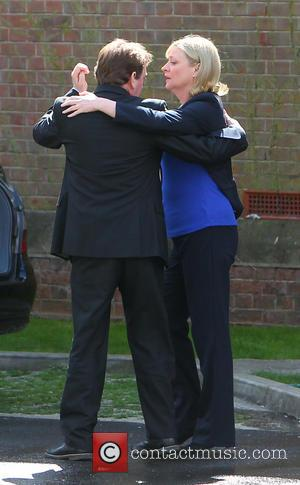 Adam Woodyatt and Laurie Brett - A distraught Ian Beale leves the church after daughter Lucy's funeral to be consoled...