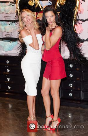 Candice Swanepoel and Adriana Lima