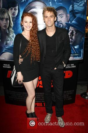 Aaron Carter and Guest - Premiere of Open Road Films' 'A Haunted House 2' held at Regal Cinemas L.A. Live...