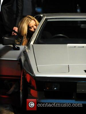 Georgia May Jagger - Georgia May Jagger is filmed stepping into a retro Lotus Esprit while shooting an advert for...