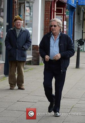 William Roache - William Roache collects as newspaper as he runs errands in Alderley Edge Cheshire - Manchester, United Kingdom...
