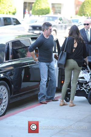 Simon Cowell, Lauren Silverman and Eric Cowell - Simon Cowell and Lauren Silverman take baby Eris to The Ivy for...