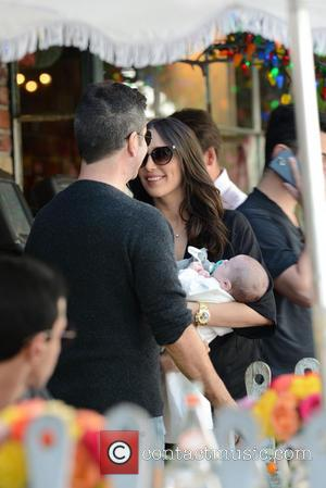 Simon Cowell, Lauren Silverman and Eric Cowell - Simon Cowell and Lauren Silverman take baby Eric to The Ivy for...