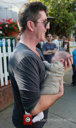 Simon Cowell and Eric Cowell - Simon Cowell and Lauren Silverman leave The Ivy with their baby son Eric -...
