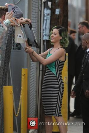 Katy Perry - Katy Perry with green highlights in her hair, greets fans as she departs Jimmy Kimmel Live! in...