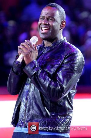 Brian McKnight - Celebrities attend the Los Angeles Clippers playoff game against the Golden State Warriors in game 2 of...