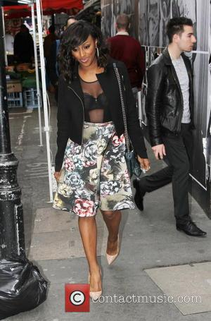 Alexandra Burke - Alexandra Burke was spotted in Soho attending business meetings wearing a revealing sheer top and floral skirt...