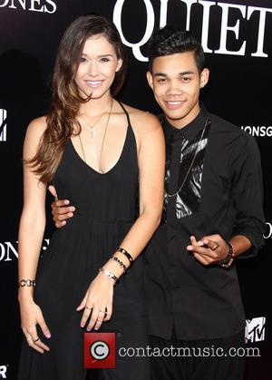 Roshon Fegan and Guest - Los Angeles premiere of 'The Quiet Ones' - Arrivals - Los Angeles, California, United States...