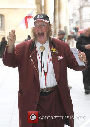 John McCririck - TV Host and reality star John McCririck celebrates St George's Day as he leaves the BBC studios...