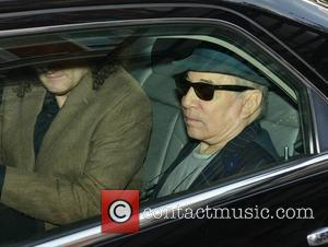 Paul Simon and Martin Hayes - Paul Simon seen leaving The Shelbourne Hotel with Irish fiddle virtuoso Martin Hayes to...