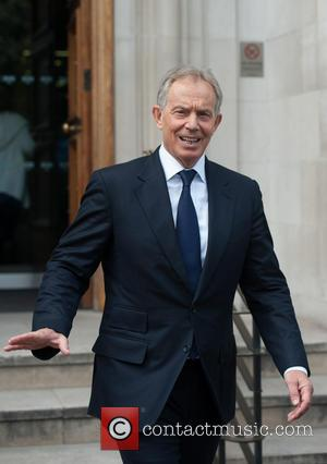 Tony Blair - Former British Prime Minister Tony Blair leaves Bloomberg's HQ in East London after delivering a lecture on...