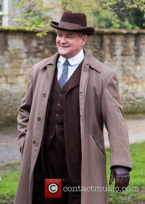 Hugh Bonneville - The cast of Downton Abbey film scenes on location outside a churchyard - Oxford, United Kingdom -...