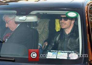 Michael Fassbender - Actor Michael Fassbender seen leaving his hotel with parents Josef & Adele Fassbender to attend the movie...