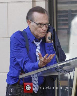 Larry King - Tavis Smiley Honored with Star on HOllywood Blvd Walk of Fame. Larry King and Jay Leno playfully...
