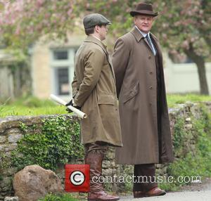 Hugh Bonneville - The cast of Downton Abbey film scenes on location outside a churchyard - Bampton, United Kingdom -...