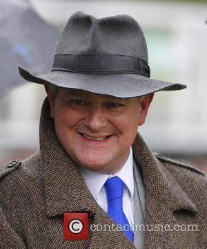 Hugh Bonneville - Hugh Bonneville at Sandown Park Racecourse. His horse, Gothic, finished 4th in the last race of the...