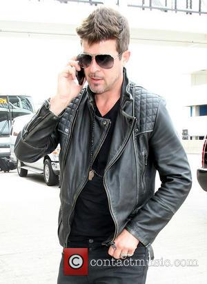 Robin Thicke - Robin Thicke arrives at Los Angeles International...
