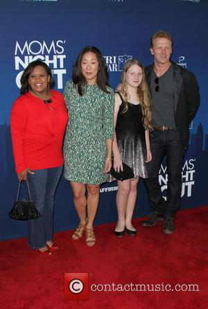 Chandra Wilson, Sandra Oh, Kevin McKidd and Iona McKidd - Premiere of 'Mom's Night Out' held at the TCL Chinese...