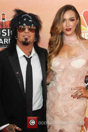 Nikki Sixx and Courtney Bingham - 2014 iHeartRadio Music Awards at The Shrine Auditorium - Los Angeles, California, United States...
