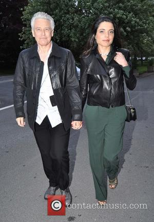 Adam Clayton and Mariana Teixeira - U2 bassist Adam Clayton and his wife Mariana Teixeira arrive at RTE studios for...
