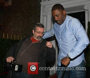 Idris Elba trips over snapper Jon Dardis - Idris Elba DJs at Bucks Townhouse with celebrity guests Adam Clayton &...