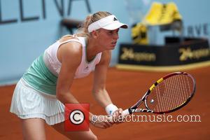 Caroline Wozniacki - Caroline Wozniacki of Denmark vs. Ekaterina Makarova of Russian during the Mutua Madrid Open tennis tournament, Women's...