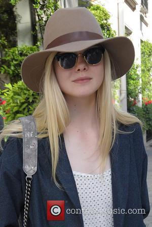 Elle Fanning - Elle Fanning outside her hotel - Paris, France - Monday 5th May 2014