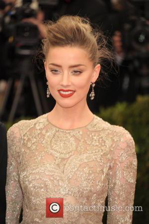 Amber Heard - 'Charles James: Beyond Fashion' Costume Institute Gala at the Metropolitan Museum of Art - Outside Arrivals -...