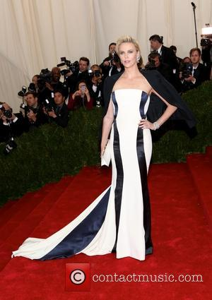 Charlize Theron - 'Charles James: Beyond Fashion' Costume Institute Gala at the Metropolitan Museum of Art - Outside Arrivals -...