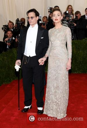 Johnny Depp and Amber Heard - 'Charles James: Beyond Fashion' Costume Institute Gala at the Metropolitan Museum of Art -...