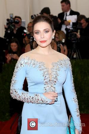 Elizabeth Olsen - 'Charles James: Beyond Fashion' Costume Institute Gala at the Metropolitan Museum of Art - Outside Arrivals -...
