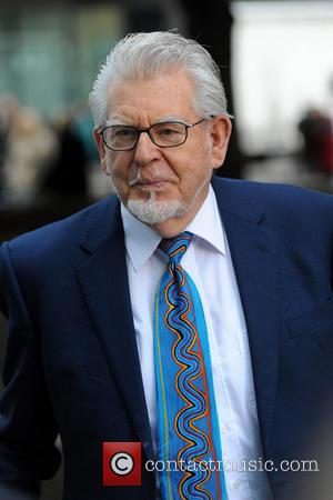 Trial Of Rolf Harris Begins, Entertainer Faces 12 Counts Of Indecent Assault