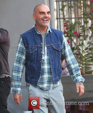 Christian Audigier - Christian Audigier and his girlfriend Nathalie Sorensen have lunch with Brazilian racing driver Tarso Marques at Bludso's...