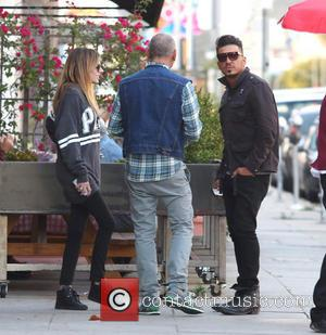 Christian Audigier, Nathalie Sorensen and Tarso Marques - Christian Audigier and his girlfriend Nathalie Sorensen have lunch with Brazilian racing...