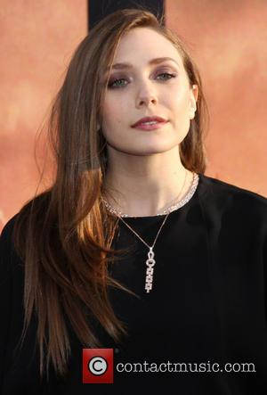 Elizabeth Olsen - Los Angeles premiere of 'Godzilla' at the Dolby Theatre - Arrivals - Los Angeles, California, United States...