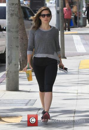 Sophia Bush - Sophia Bush puts some money into a parking meter and stops off at Starbucks to grab a...