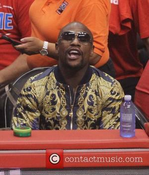 Floyd Mayweather Jr. - Celebrities watch the Los Angeles Clippers playoff game at the Staples Center. The Oklahoma City Thunder...