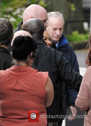 Emeli Sande - Security staff sneak Emeli Sande in the side door of the Queen Margaret Union as she attends...