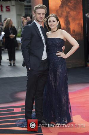 Boyd Holbrook and Elizabeth Olsen - European premiere of 'Godzilla' held at the Odeon Leicester Square - Arrivals - London,...