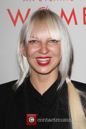 We Defy You To Keep A Straight Face With Sia's Rendition Of 'Annie' Song 'You're Never Fully Dressed Without A Smile' [Video]