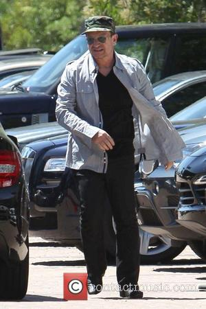 Bono - George Clooney and his fiancé Amal Alamuddin  exit Cafe Habana after spending Mother's Day dining with Bono....