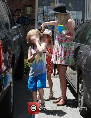 Tori Spelling, Liam McDermott and Stella McDermott - Tori Spelling visits a masseur in Woodland Hills with her two children,...
