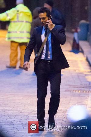 Benjamin Bratt - Benjamin Bratt talking on his mobile phone on location filming Fox network TV series '24'. - London,...