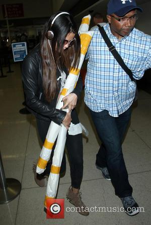 Selena Gomez - Selena Gomez at Los Angeles International Airport