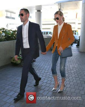 Kate Bosworth and Michael Polish - Kate Bosworth wearing three quarter length jeans, brown jacket and silver high heels, leaves...