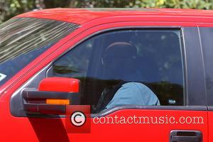Suge Knight - Suge Knight seen sitting in his car at the Four Seasons hotel. - Los Angeles, California, United...